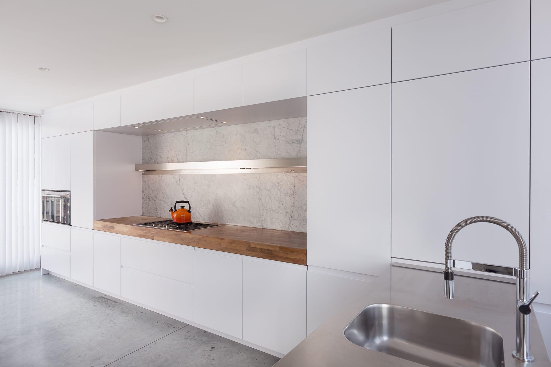 Werkblad Keuken Hout : Arclinea keuken houten werkblad en dekton spatwand si accomodi